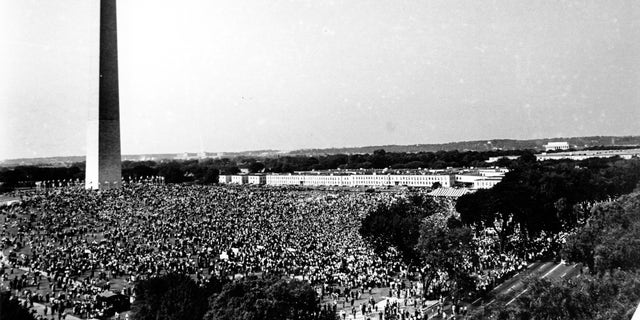 "This Aug. 28, 1963, file photo shows civil rights demonstrators gather at the Washington Monument grounds before noon, before marching to the Lincoln Memorial, seen in the far background at right, where the March on Washington for Jobs and Freedom will end with a speech by Rev. Martin Luther King Jr., now known as the ""I Have A Dream"" speech. (AP Photo, File)"