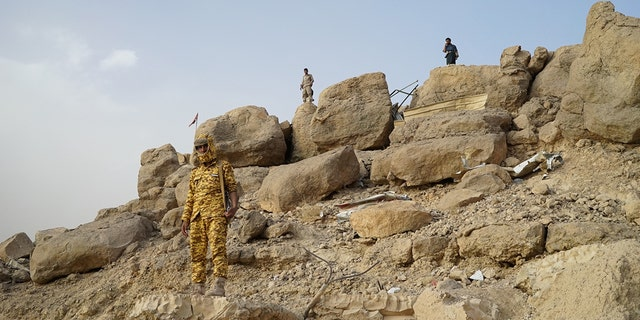 Soldiers surround Marib's Great Dam.