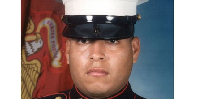 This undated photo released by the U.S. Marines shows Sgt. Rafael Peralta, 25.