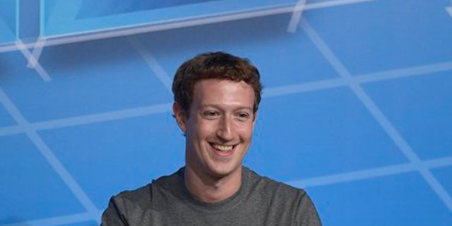 FILE - This Feb. 24, 2014 file photo shows Facebook Chairman and CEO Mark Zuckerberg during a conference in Barcelona, Spain. President Barack Obama is meeting with CEOs from leading Internet and technology companies to discuss their concerns about privacy and National Security Agency programs. The White House says Obama will host the leaders Friday in the Oval Office. The meeting comes two months after Obama gave a speech proposing changes to NSA spying programs following public and industry concern. Google CEO Eric Schmidt and Netflix CEO Reed Hastings will join the meeting. So will Drew Houston of the file storage site Dropbox and Mark Zuckerberg of Facebook.  (AP Photo/Manu Fernandez, File)