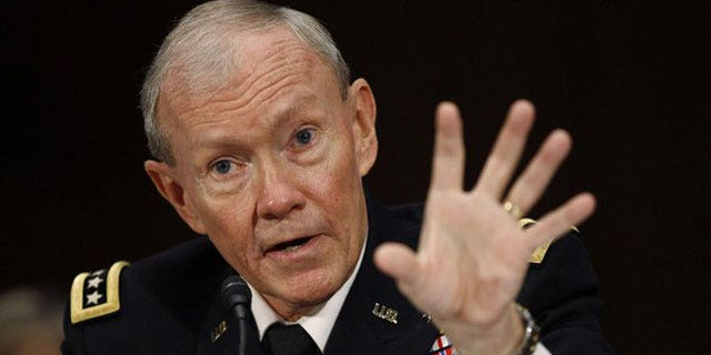 July 26: U.S. Army General Martin Dempsey speaks at his confirmation hearing for Chairman of the Joint Chiefs of Staff, on Capitol Hill in Washington.