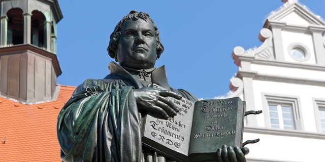 Monument of Martin Luther in Wittenberg, Germany. It was the first public monument of the great reformer, designed 1821 by Johann Gottfried Schadow. Martin Luther (1483-1546) was a German monk, theologian, and church reformer and the translator of the bible into German. He is also considered to be the founder of Protestantism. He lived and worked many years in Wittenberg.