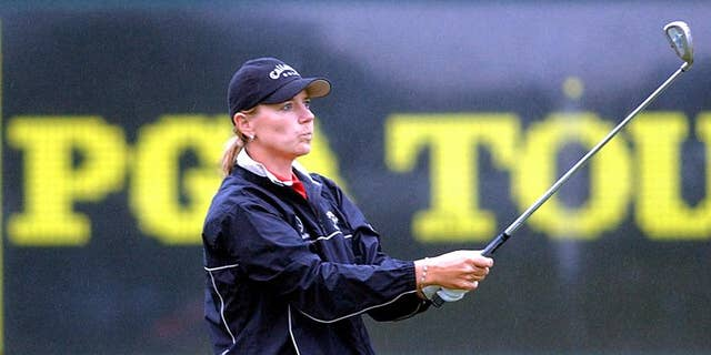 FILE - This is a May 20, 2003, file photo showing golfer Annika Sorenstam hitting in the rain at the driving range of the Colonial Country Club in Fort Worth, Tx. Annika Sorenstam ranks among the best female golfers of all-time. She's still the richest, with career earnings of more than $22 million, despite retiring in 2008. But what fans remember most about the Swedish superstar might be the time she mixed it up with the boys on the PGA Tour at the Colonial in 2003. (AP Photo/Dave Martin, File)