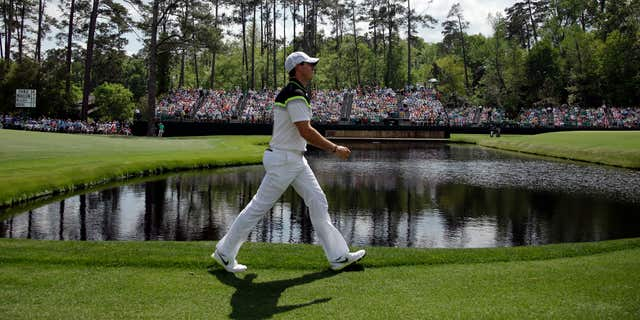 April 9, 2015: Rory McIlroy, of Northern Ireland, walks on the 15th fairway during the first round of the Masters golf tournament.