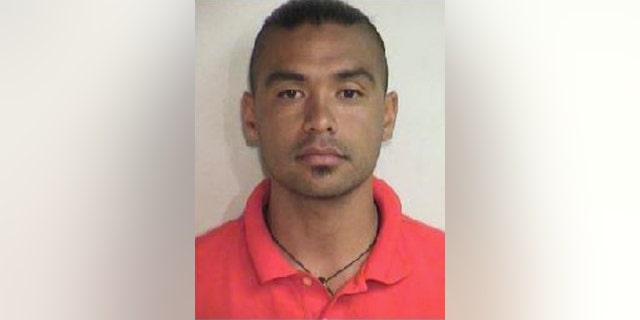 This Aug. 20, 2015 booking photo released by the Maui County Police Department shows Joshua Mangauil, who was one of several people arrested early Thursday, Aug. 20, 2015, during a protest against a Maui solar telescope, in the effort to stop a giant telescope on the Big Island. Protesters gathered Wednesday night to attempt to stop a convoy delivering materials to Haleakala, where the Daniel K. Inouye Solar Telescope is being built. (Maui County Police Department via AP)
