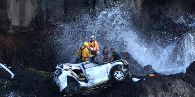 """Witnesses said they saw the Duvals' SUV accelerate, then take a """"sharp left"""" turn onto a rock wall, before it plunged 200 feet off a cliff."""