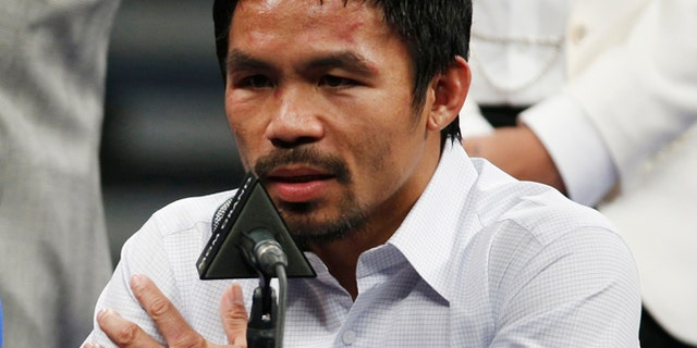MAY 2: Manny Pacquiao answers questions during a press conference following his welterweight title fight against Floyd Mayweather Jr. in Las Vegas.