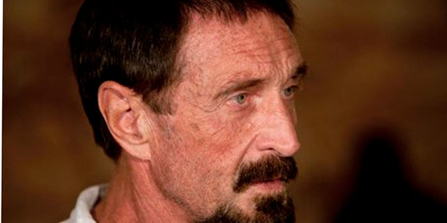 """Software company founder John McAfee listens to a question during an interview at a local restaurant in Guatemala City, Tuesday, Dec. 4, 2012.  McAfee, 67, has been identified as a """"person of interest"""" in the killing of his neighbor in Belize, 52-year-old Gregory Faull. Police are urging McAfee to come in for questioning. The anti-virus company founder fled Belize and is seeking political asylum in Guatemala, according to his lawyer Telesforo Guerra. (AP Photo/Moises Castillo)"""