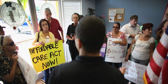 Daniel Martinez, an aide to Florida State Rep. Manny Diaz, speaks to protesters on September 20, 2013 in Miami, Florida.