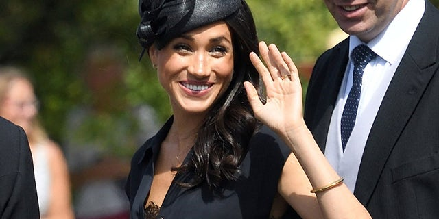 Markle on  her 37th birthday arrived at Prince Harry's friends wedding with her top accidentally unbuttoned revealing a lacy bra underneath.