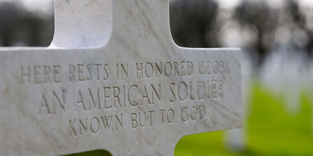 FILE - In this Friday, March 24, 2017 file photo, a gravestone marker for an unknown American soldier sits in the rows crosses at the Meuse-Argonne American cemetery in Romagne-sous-Montfaucon, France. NATO's memorial recalls those killed on allied missions, but few know the names of the dead. NATO officials usually refer back to the member nations but the lack of clarity becomes a more poignant question as Monday's U.S. Memorial Day draws closer. (AP Photo/Virginia Mayo, File)
