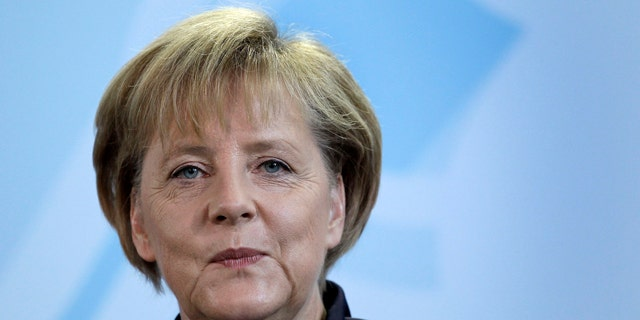 September 6: German Chancellor Angela Merkel  attends a news conference at the chancellery in Berlin, Germany. (AP)