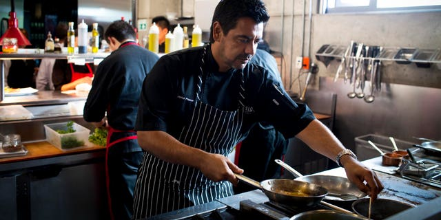 Sept. 27, 2012: Chef Javier Plascencia cooks in the kitchen at Mission 19 restaurant in Tijuana, Mexico. Plascencia is part of a group of chefs working to create a unique cuisine largely based on fresh seafood caught in the seas flanking Baja and the produce from its fertile valley.