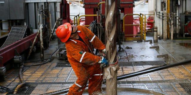 Oil worker on the Centenario deep-water drilling platform off the coast of Veracruz, Mexico, on Nov. 22, 2013.
