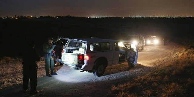 HIDALGO, TX - APRIL 10:  A U.S. Border Patrol Agent inspects a pickup truckload of marijuana seized from drug smugglers near the U.S.-Mexico border on April 10, 2013 in Hidalgo, Texas. The agents, guided by helicopter surveillance from the U.S. Office of Air and Marine, waited more than four hours in hiding before seizing more than 900 pounds of the drug. The smugglers ran and escaped by swimming back across the Rio Grande River into Mexico. Border Patrol agents say they have also seen an additional surge in immigrant traffic since immigration reform negotiations began this year in Washington D.C. Proposed refoms could provide a path to citizenship for many of the estimated 11 million undocumented workers living in the United States.  (Photo by John Moore/Getty Images)