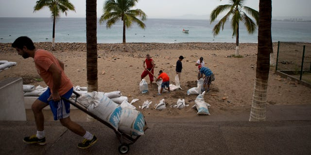 Oct. 23, 2015 -Residents prep for Hurricane Patricia filling sandbags to protect beachfront businesses in Puerto Vallarta, Mexico. Patricia barreled toward southwestern Mexico Friday as a Category 5 storm, the strongest ever in the Western Hemisphere. Locals and tourists were either hunkering down or trying to make last-minute escapes.