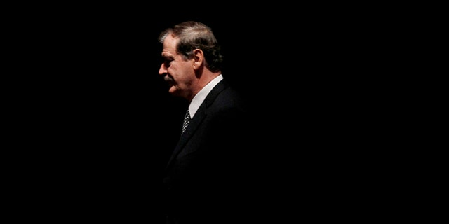 FILE - In this Oct. 18, 2011, file photo, former President of Mexico Vicente Fox walks on stage to speak at the CATO Institute in Washington. Mexicans backed former President Fox in his verbal spat with Donald Trump on Friday, Feb. 26, 2016, after Fox called the Republican front-runner crazy and a false prophet and Trump replied that he ought to be ashamed of himself. (AP Photo/Pablo Martinez Monsivais, File)
