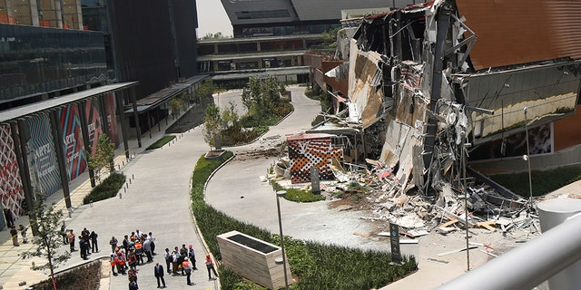 The Artz Pedregal shopping mall stands partially collapsed on the south side of Mexico City, Thursday, July 12, 2018. The newly opened shopping mall partly collapsed after structural problems apparently led the mall's operators to evacuate the area, and no injuries were reported.