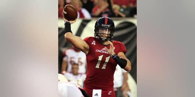 Cincinnati's quarterback Gunner Kiel passes the ball against Miami (Ohio) in the first half of an NCAA college football game in Cincinnati, Saturday, Sept. 20, 2014. (AP Photo/Tom Uhlman)