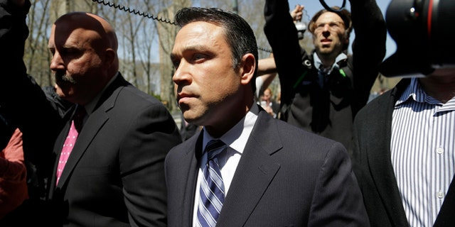 U.S. Rep. Michael Grimm leaves federal court in New York, Monday, April 28, 2014. Grimm was taken into custody Monday to face federal charges following a two-year investigation of his campaign financing. (AP Photo/Seth Wenig)