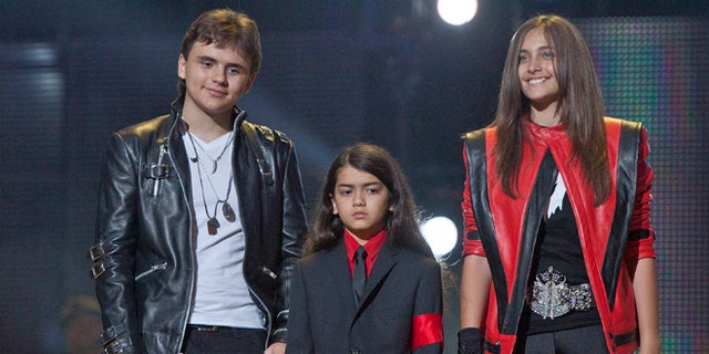 """Oct. 8, 2011: In this file photo, from left, Prince Jackson, Prince Michael II """"Blanket""""Jackson and Paris Jackson arrive on stage at the Michael Forever the Tribute Concert, at the Millennium Stadium in Cardiff, Wales."""