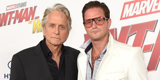 """Michael Douglas, left, and Cameron Douglas arrive at the Los Angeles premiere of """"Ant-Man and the Wasp"""" at El Capitan Theatre on Monday, June 25, 2018. (Photo by Jordan Strauss/Invision/AP)"""