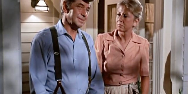 "Ralph Waite and Michael Learned in ""The Waltons."""