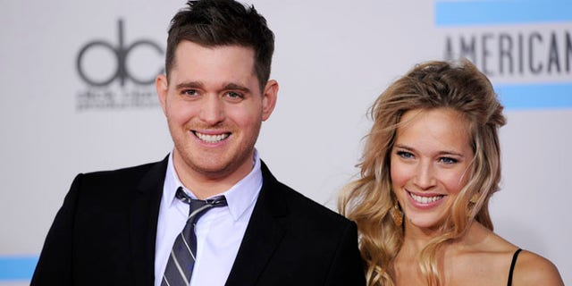 Nov. 21, 2010: This file photo shows Michael Buble, left, and Luisana Lopilato at the 38th Annual American Music Awards in Los Angeles.