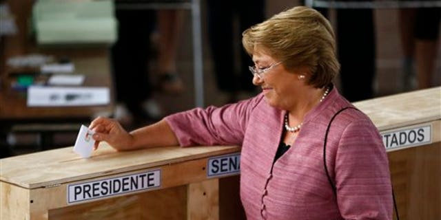 Presidential candidate Michelle Bachelet votes during the general elections in Santiago, Chile. (AP Photo/Victor R. Caivano)