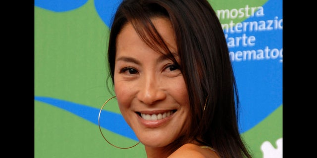 """**FILE**Actress Michelle Yeoh poses during the photo call for the movie """" Far North"""" at the 64th edition of the Venice Film Festival in Venice, Italy, Thursday, Aug. 30, 2007.  Yeoh will be awarded France's Legion of Honor in an Oct. 3 ceremony in the Malaysian capital of Kuala Lumpur, French Foreign Ministry officials said Tuesday, Sept. 11, 2007.(AP Photo/Luigi Costantini)"""