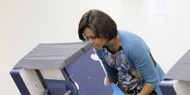 First lady Michelle Obama casts her ballot at an early voting location in Chicago, Oct. 14, 2010. (AP Photo)