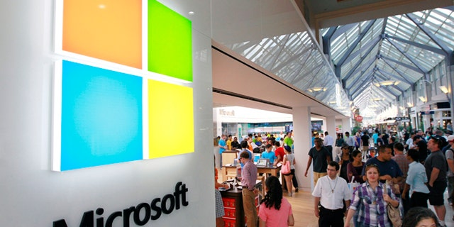The Microsoft logo is seen on an exterior wall of a Microsoft store inside the Prudential Center mall in Boston. Microsoft will use its annual developers conference to release a preview of Windows 8.1 beginning June 26.