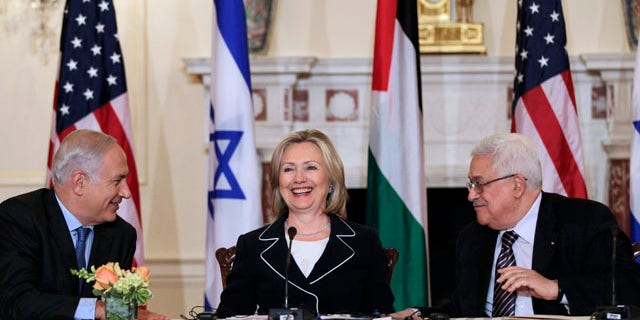 September 2: Israeli Prime Minister Benjamin Netanyahu, and Palestinian President Mahmoud Abbas, smile after an opening session of face-to-face peace talks hosted by Secretary of State Hillary Rodham Clinton at the State Department in Washington. (AP)
