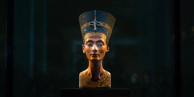 In this Sept. 10, 2014 file photo, a 3,300-year-old bust of Queen Nefertiti stands on its socle, at the New Museum in Berlin, Germany.