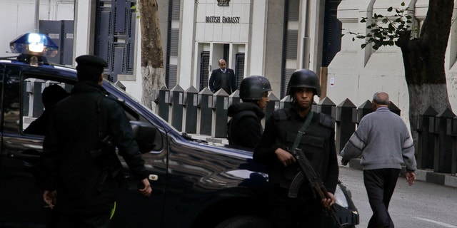 Dec. 8, 2014 - Security forces deployed in front of the British embassy in Cairo, Egypt, which closed to the public for the second day Monday, over security concerns. The Canadian Embassy also announced its closure Monday.