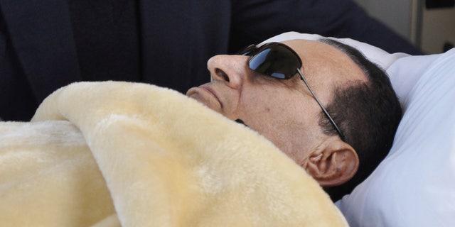 FILE - former Egyptian President Hosni Mubarak is wheeled into court in Cairo, Egypt.