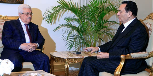 Dec. 9: Egyptian president Hosni Mubarak, right, meets with Palestinian authority president Mahmoud Abbas at the Presidential palace in Cairo, Egypt. Talks come within the framework of efforts aimed at reviving the Middle East peace process.