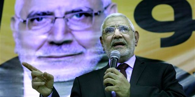 March 9: Egyptian presidential hopeful Abdel-Moneim Abolfotoh, a Muslim Brotherhood figure, talks under a giant billboard showing his picture during a conference in Cairo, Egypt.
