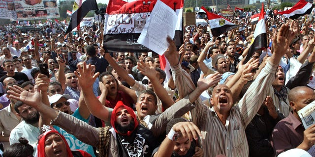Several thousand Egyptians protesters shout against the country's military rulers at Tahrir Square, the focal point of Egyptian uprising, in Cairo, Egypt, Friday, Sept. 30, 2011. (Associated Press)
