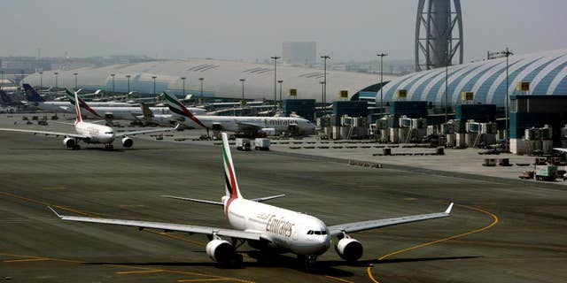 FILE - In Tuesday April 20, 2010 file photo, an Emirates airline passenger jet taxis on the tarmac at Dubai International airport in Dubai, United Arab Emirates. Officials say the Mideast's busiest airport in Dubai will undergo a major runway overhaul starting next month that will see more than a dozen airlines shift flights to another airport in the city. (AP Photo/Kamran Jebreili, File)