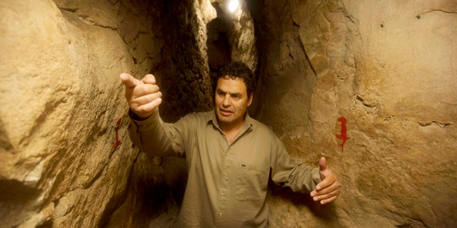 May 1, 2014: Eli Shukron, an archeologist formerly with Israel's Antiquities Authority, walks in the City of David archaeological site near Jerusalem's Old City. The dig, which began in 1995, uncovered a massive fortification and pottery shards that date to 3,800 years ago. Shukron says this is the legendary citadel captured by King David in his conquest of Jerusalem. But archaeologists are divided on identifying Davidic sites in Jerusalem, the city he is said to have made his capital. (AP Photo/Sebastian Scheiner)