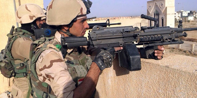 Oct. 16, 2015: Iraqi security forces  stand guard after regaining control of Tamim district in southern Ramadi, Iraq.