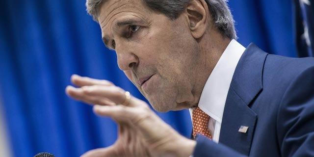 June 23, 2014: U.S. Secretary of State John Kerry speaks during a press conference at the U.S. Embassy in Baghdad, Iraq. (AP Photo/Brendan Smialowski, Pool)