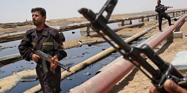 Iraqi Forces guarding oil fields.