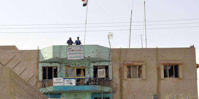 October 3: Iraqi police inspect the damaged at their police station in al-Baghdadi west of Ramadi, 70 miles (115 kilometers) west of Baghdad, Iraq.