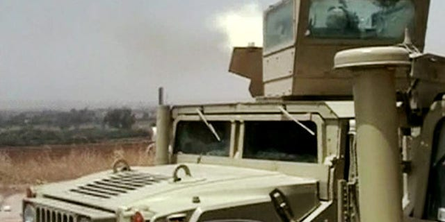 Monday, June 9, 2014 image taken from video obtained from the Iraqi Military, which has been authenticated based on its contents and other AP reporting, an Iraqi army tank fires towards militants during clashes in in the northern city of Mosul, Iraq. Insurgents on Tuesday pressed their efforts to seize effective control of Iraqs second-largest city of Mosul on Tuesday after Iraqi security forces abandoned their posts and militants overran the provincial government headquarters and other key buildings, dealing a serious blow to Baghdads attempts to tame a widening insurgency in the country.