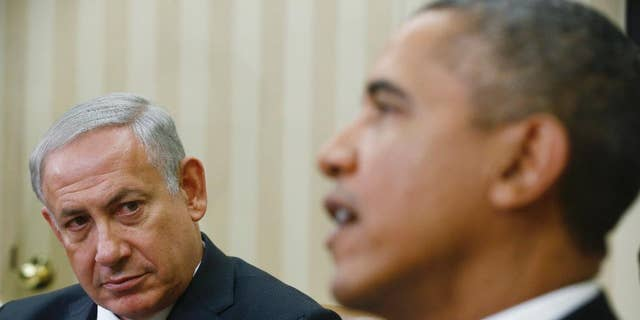 FILE - In this Sept. 30, 2013 file photo, President Barack Obama meets with Israeli Prime Minister Benjamin Netanyahu in the Oval Office at the White House in Washington. Despite Netanyahu's speech to Congress, his efforts to halt the Iranian nuclear program which he describes as the mission of his lifetime appear to be stumbling as the U.S. seems to move toward a deal with the Islamic Republic. (AP Photo/Charles Dharapak, File)