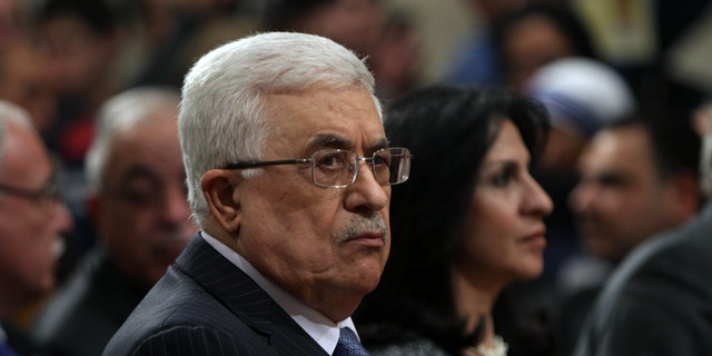 Dec. 25, 2012 - FILE photo of Palestinian President Mahmoud Abbas, attending Christmas Midnight Mass at Saint Catherine's Church in the West Bank town of Bethlehem.