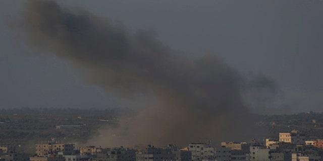 August 10, 2014: Smoke from an Israeli strike rises over Gaza City.  (AP Photo/Lefteris Pitarakis)