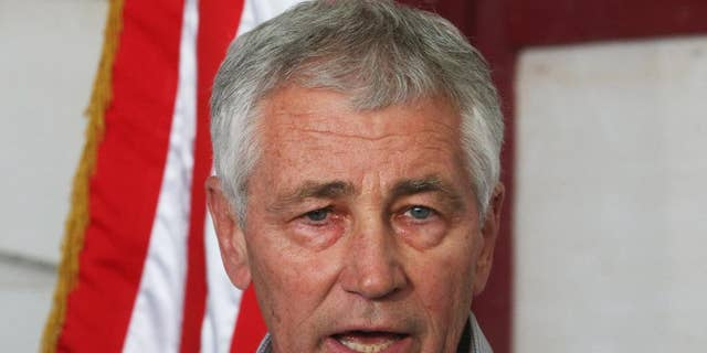U.S. Secretary of Defense Chuck Hagel speaks during a press conference after visiting U.S. troops in Kuwait City, Monday, Dec. 8, 2014. Hagel visited the camp which once was a staging post for troops headed to Iraq. (AP Photo/Mark Wilson, Pool)